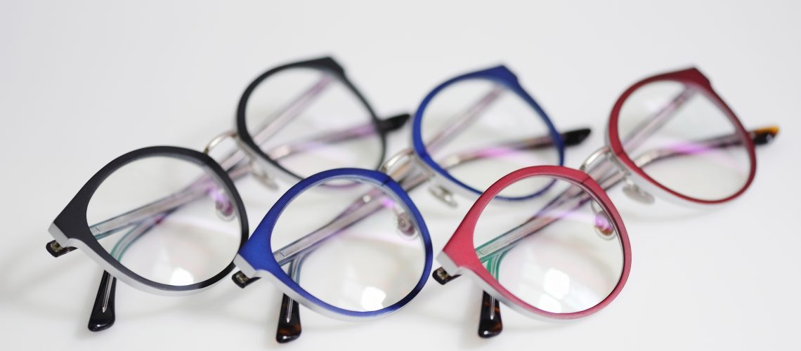 Multicolored glasses on the white background